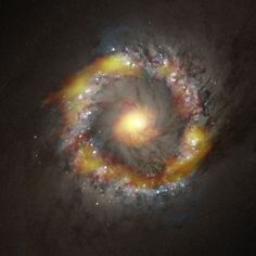 Week's Best Space Pictures: Black Hole Bursts, Storms Swirl