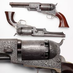 Presentation Dragoons: Colt Third Model Dragoon Revolvers - Presentation engraved by Gustave Young for a member of the Mounted Rifles, this pair of six-shot percussion revolvers represents one of the finest sets given as a shooting prize by the Colt company. A total of 10,500 Third Model Dragoon revolvers were made from 1851-61. At the NRA National Firearms Museum in Fairfax, VA.