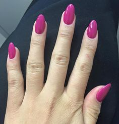 almond round nails with a berry polish