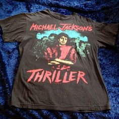 Vintage Michael Jackson Thriller T-Shirt Super soft and worn but in excellent condition. Let me know if you want it washed before sending incase of allergies. Men's size medium. Very comfy. Bravado Tops Tees - Short Sleeve