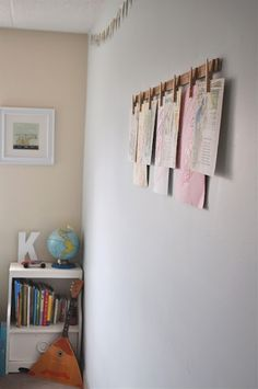 Clothespins & yard stick art hanger.