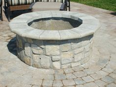 Outdoor Fireplaces & Fire Pits: Rustic Cleft Veneer with Aux Vases Blue Coping  www.earthworksstone.net