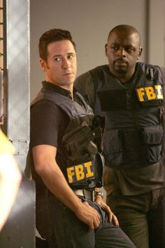 Don Eppes (Rob Morrow) and David Sinclair (Alimi Ballard) in Numb3rs.