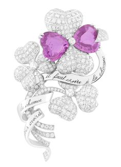 Van Cleef & Arpels. Palais de la chance High Jewellery collection. Your-charm nature, Trèfles clip, white gold, 2 heart-shaped pink sapphires weighing 15.27 carats in total and diamonds. – photo via Van Cleef & Arpels