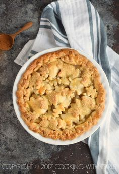 This Bourbon-Pear Pie is sure to impress your friends and family with it's glistening leaf cut-out crust, tender pears, and spiced filling!
