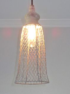 """New meets vintage style! Made with a weathered off white wire that looks like it is an antique lantern. This would make a great addition to a kitchen, laundry room, mudroom, barn, etc. The """"lantern"""" i"""