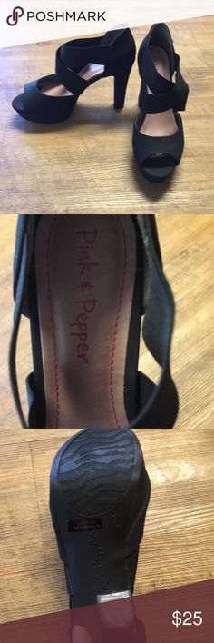 Black size 9 peep toe heels Worn one time for just a few minutes. To small for me. My loss is your gain. The straps at the top are a stretchy elastic. One small scuff, please see pictures. Pink & Pepper Shoes Heels