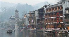 Many hostels and restaurants in Fenghuang, Hunan province, offer customers views into the Tuojiang River.  Source: Xinhua
