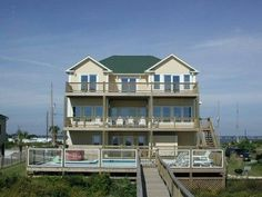 1 Emerald Oasis is an oceanfront cottage with 6 bedrooms and 4.5 bathrooms. Relax after a day at the beach on one of the many decks or in the 20' x 30' gated and heated swimming pool.