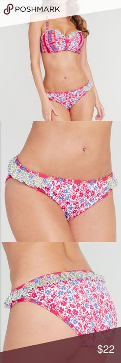 Santana Frill Bikini Brief In a vibrant floral print, the Midnight Grace by Figleaves.com Santana Frill Bikini Brief exudes femininity. Designed to flatter, this bikini brief features a contrasting frill trim at the sides and back for a flirtatious finish.  Washing: Hand wash separately Material: 80% Nylon 20% Elastane Brand: figleaves Range Name: Santana Product Master Code: FIG-147136 Midnight Grace by Figleaves.com Swim