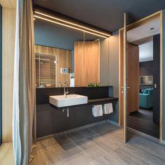 Appartementhaus Fuxbau Stuben | Atelier Ender | Architektur Bathroom Lighting, Mirror, Furniture, Home Decor, Atelier, Roof Trusses, Birthing Center, Ground Floor, Architecture