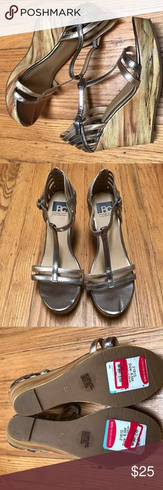 """NEW BC Footwear Women's I Got It Wedge Sandal 8.5M These adorable rose gold & bronze metallic wedges feature a sophisticated T-strap design and adjustable ankle strap with buckle closure. Lightly padded insole. Wedge heel. Approx. 4"""" heel, 1.5"""" platform. BC Footwear Shoes Sandals"""