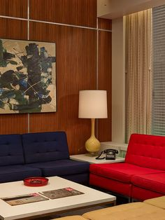 From the Sets of Mad Men: classic mid-century panelling but the aluminium bars lift and lighten the overall look. Great triadic colour scheme in the sofas.