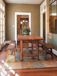 A farmhouse table set brings some nice rustic style to this dining room. | Photo: Laurey W. Glenn | Stylist: Lisa Powell | Designer: Sandra Allen Lynn | thisoldhouse.com