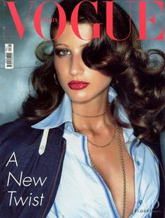 Michelle Alves featured on the Vogue Italy cover from May 2002