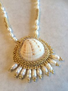 Venus shell necklace and earrings by Beadgardener on Etsy https://www.etsy.com/listing/253298289/venus-shell-necklace-and-earrings