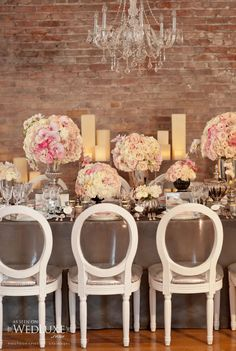 "Very elegant - shabby chic to the power of at least three! But absolutely needs these gorgeous chairs and the gritty backdrop. Candelabras (stained silver, four-arm) would be nice instead of the pillar candles. And maybe the florals should be a little less ""sweet and creamy."" But great inspiration!"