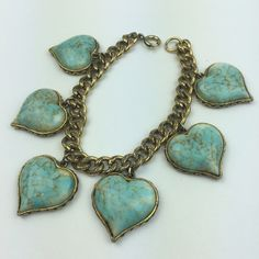 """[Vintage] Heart Charm Bracelet Boho Gypsy Chic Fun Fun piece of vintage costume jewelry. Chunky gold tone chain with heart charm accents. Faux turquoise stone charms in a unique setting. Clasp closure.  Length: 8"""" Condition: EUC. No flaws.  No Trades! Vintage Jewelry Bracelets"""