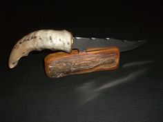 Handmade Sheep Horn handle, stainless steel knife, hand file work and custom made stand, plush lined case. via Etsy.