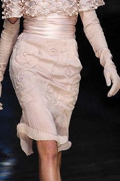 Valentino. Love the color and LOVE the wrinkled edged curled up. Very Paris and old world