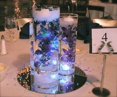 Wedding blue table decorations floating candles New Ideas Blue Orchid Centerpieces, Floating Flower Centerpieces, Floating Candles, Table Centerpieces, Pillar Candles, Wedding Centerpieces, Table Decorations, Centerpiece Ideas, Table Arrangements