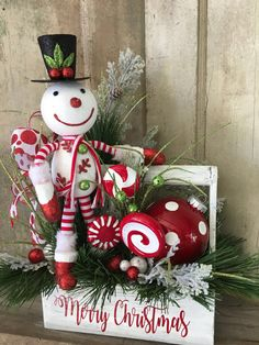A personal favorite from my Etsy shop https://www.etsy.com/listing/486811431/christmas-snowman-arrangement-merry