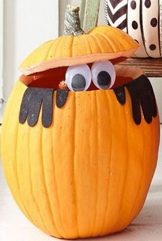 gloves and big eyes peeking out of a carved pumpkin - maybe decoupauge a old plastic pumpkin and then decorate
