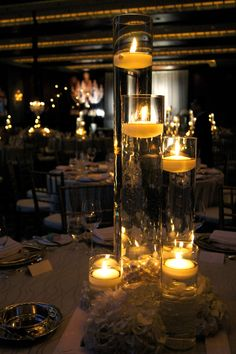 Wedding Candle Centre Pieces, love this idea.:) love the candles with the water.