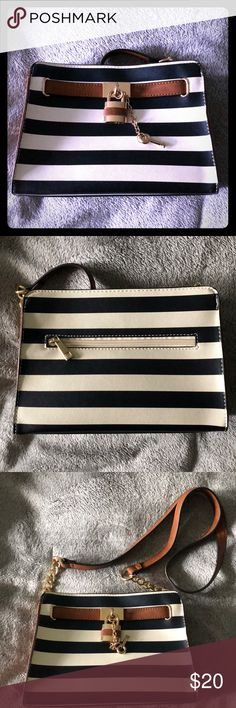 Call It Spring Nautical Purse Worn once. Navy white and brown nautical themed purse with gold detail. Lock and key. There is a tiny dot stain on the front as pictured. Comes from a smoke and pet free home. Please feel free to ask questions and make offers! I bundle!! Call It Spring Bags Crossbody Bags