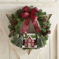 Our unique wreath combines all of our favorite Christmas traditions. With its festive combo of plaid, natural pinecones, village house and bright, pre-lit LEDs, it's a warmer-than-ever welcome for your front door.