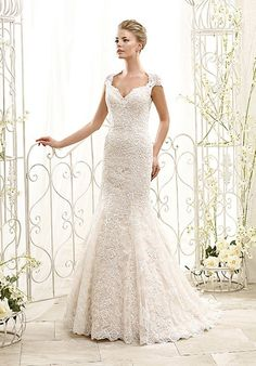 Style 77986 by Eddy K. This gown has venice lace over soft tulle. l TheKnot.com