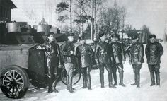 Members of The 7th Armored Squadron standing beside Fiat-Izhora armored cars, Petrograd, 1920.