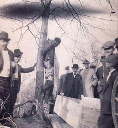 John Richards, 12/07/1916, Goldsboro, North Carolina.  Notice his pants are down as he has been castrated.