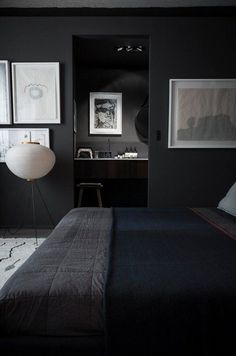 "You've no doubt seen rooms employ a ""pop of color"" to add interest to a neutral space. There's an endless rainbow of hues that can do the same for you at home, but if you happen to be buying in to 2016's on-trend moody, dark rooms, there's also another unexpected color pop option on the proverbial table: White."