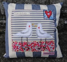 Applique Cushion by Sophie Harding  £49.00 Code SHA104