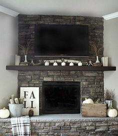 "I like the TV above it with limited intrusion. Kinda looks like it ""belongs"" there. If you didn't have a center piece fire place you could always put a picture there."