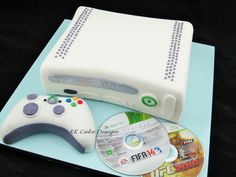 Xbox coconut cake with edible console and controller. 12th Birthday, Birthday Cakes, Birthday Ideas, Birthday Parties, Xbox One Cake, Xbox Party, Cupcake Cakes, Cupcakes, Game Themes