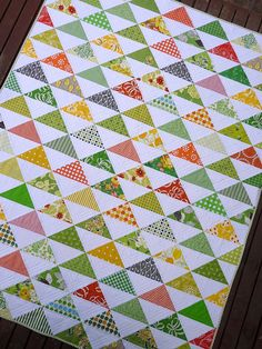"HST Scrap Quilt - on my to do list for ""one day"" and on point like this quilt! Maybe arrange by color fading from top to bottom?"