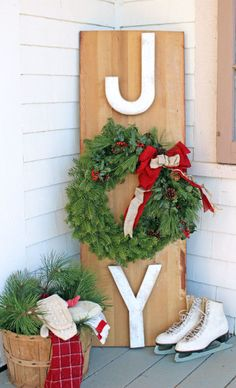 Easy to make, this propped up sign is made complete with a wreath and ice skates.