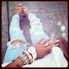 Holes in jeans & stacked bracelets