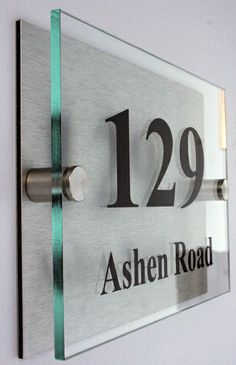 Brushed Aluminum Backplate with Glass and Cut Vinyl Lettering