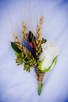Fly-fish and wheat boutonniere- like the fly but not the wheat