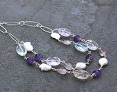 Necklace with wire wrapped amethyst, crack crystal quartz, rose quartz and freshwater pearls. Sterling silver chain and toggle