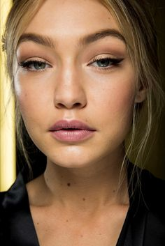 chanel bags and cigarette drags | Gigi Hadid backstage at Dolce & Gabbana Fall 2015.