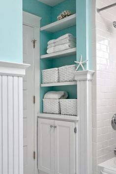 Love aqua and white... perhaps I could pull it off in the guest bathroom as well?