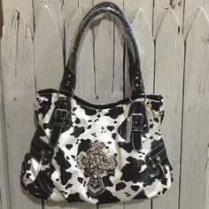 Cow Print Purse Super cute cow Cow print purse! Medium-large size bag ! Also comes with dust bag!!                   ❤️ Prices are negotiable but please be considerate due to Poshmark fees are 20% ❤️ OFFER button is always the best ❤️ Bundles receive great discounts ❤️ SAME day shipping ❤️ No Trades, No holds , No PayPal  ❤️ Happy Poshing  Bags Shoulder Bags