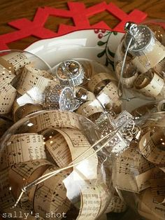 #DIY Ornament with Vintage Hymnal Pages tutorial #crafts!!! Bebe'!!! Clear crystal ornaments filled with curls from vintage hymnals( no longer usuable) make festive holiday ornaments!!!