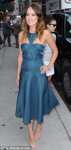 Gorgeous: The 29-year-old starlet's ladylike turquoise frock featured a collar, knotted bra-top, and full skirt