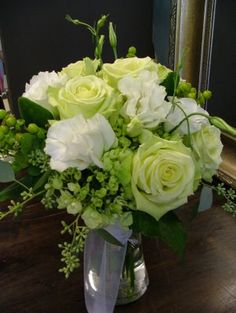 Bridesmaid Bouquet Inspiration - green and white with a mix of roses, hypericum berries, and hydrangea