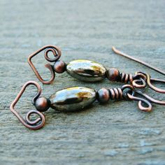 Silver Belly Bear Hug Heart dangles wire wrapped antiqued copper earrings via Etsy